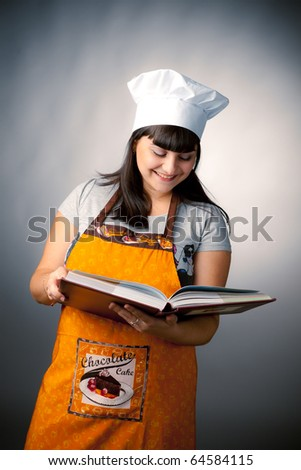 woman cook reading recipes - stock photo