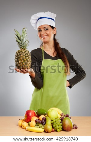 Woman cook with a bunch of various fruits on the wooden board