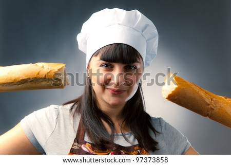 woman cook with broken french bread - stock photo