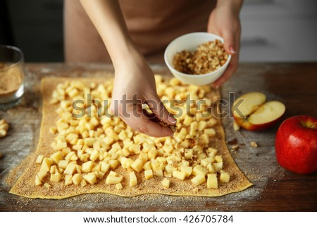 Woman cooking apple pie - stock photo