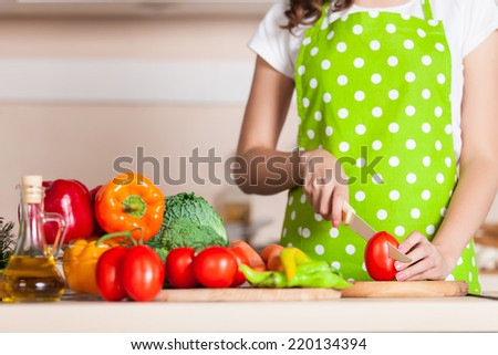 woman cooking dinner on the kitchen - stock photo