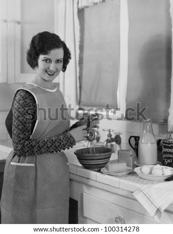Woman cooking in kitchen - stock photo