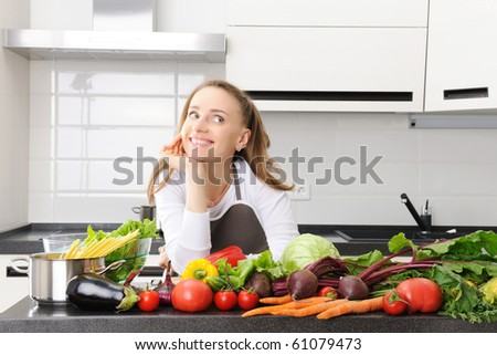 Woman cooking in modern kitchen - stock photo