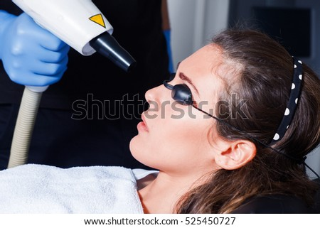 woman cosmetic face laser treatment