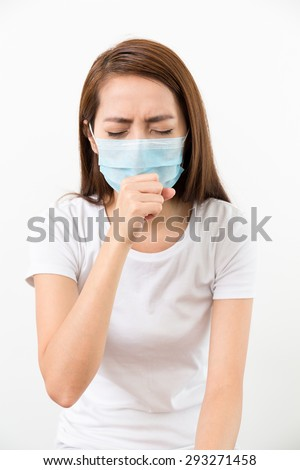 Woman cough though medical face mask - stock photo