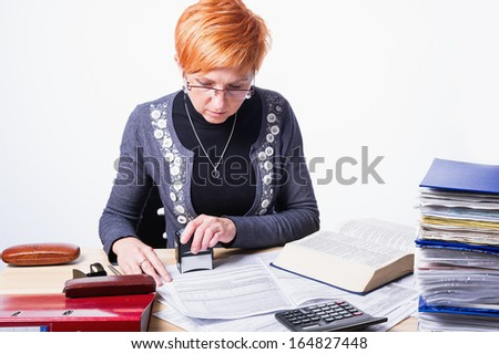 woman counts taxes on a white background