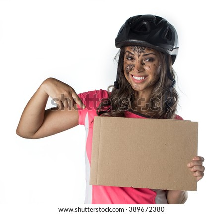 Woman covered in mud when riding a bike - stock photo