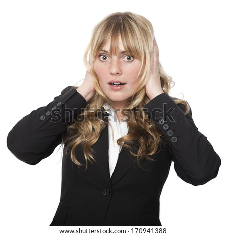 Woman covering her ears with her hands with a shocked expression as she tries to block out a sound or words that someone is saying, isolated on white - stock photo