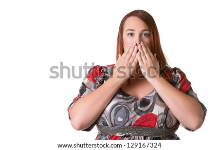 Woman covering her mouth with her hands - stock photo