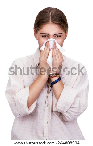 Woman covering her nose with a white tissue trying to escape the virus contagion, isolated on white - stock photo