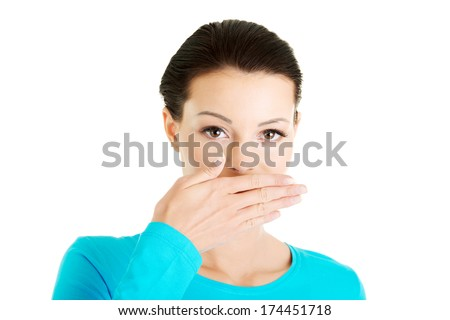 Woman covering mouth with hand , isolated  - stock photo