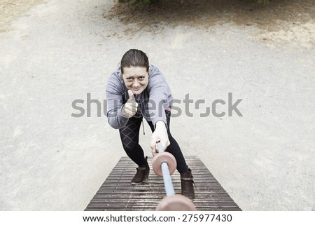 Woman crawling in an urban park, sport - stock photo