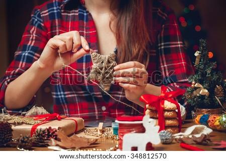 Woman creates a woolen star - stock photo