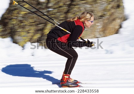 Woman cross-country skiing - stock photo