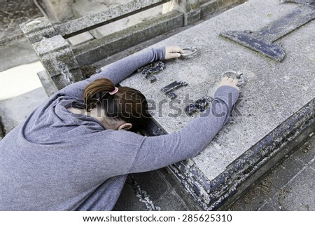 Woman crying burial cemetery, religion - stock photo