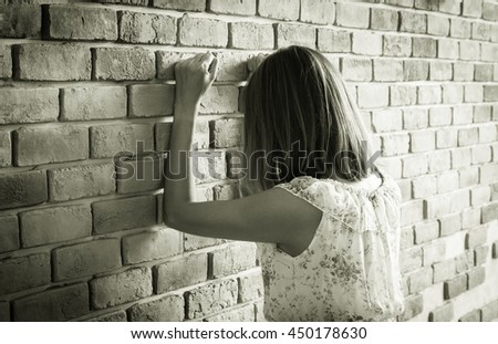 Woman crying with wall,monochrome filtered. - stock photo