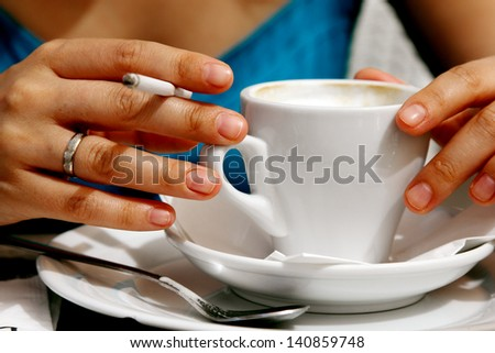 woman, cup of coffee and cigarette - stock photo