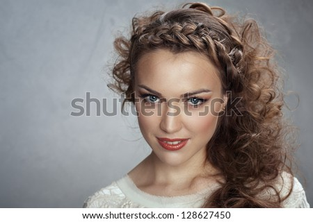 Woman curly hair on a gray background - stock photo