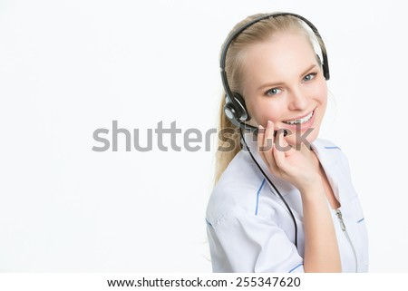 Woman customer service worker, call center smiling operator - stock photo