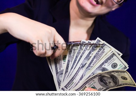 Woman cuts dollar scissors - stock photo