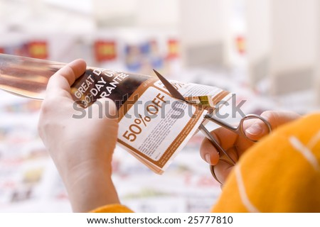 Woman cutting abstract discount coupon - stock photo