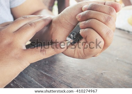 Woman cutting nails