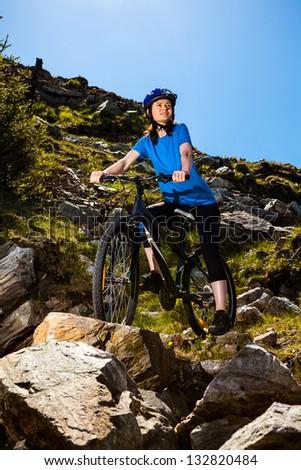 Woman cycling - stock photo