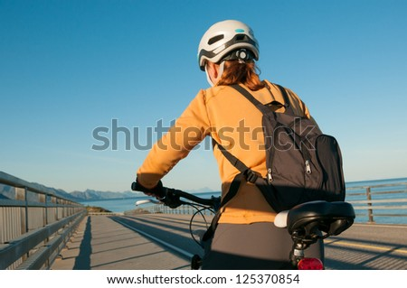 woman cycling outdoors - stock photo