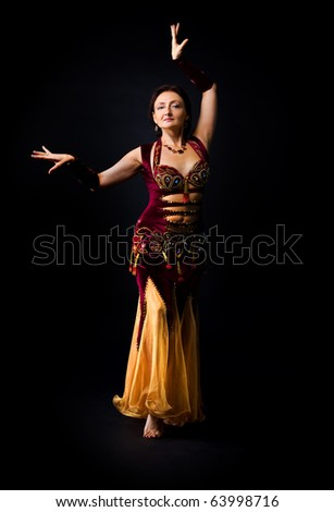 Woman dance in dark - traditional arabic costume