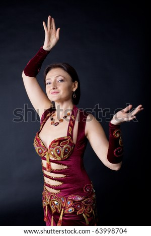 Woman dance in traditional arabic costume