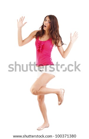 Woman dancer cheerful, happy and smiling with arms raised - stock photo