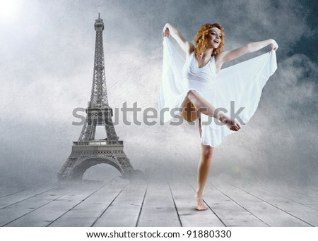 Woman dancer seating posing on the Eiffel tower background - stock photo