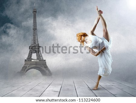 Woman dancer stay posing on the Eiffel tower background - stock photo