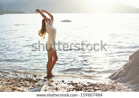 woman dancing in a sunlight - stock photo