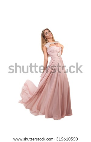 Woman dancing in fluttering dress, with waving fabric, isolated white background - stock photo