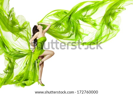 Woman dancing in green dress, beautiful fluttering and waving fabric, isolated white background - stock photo