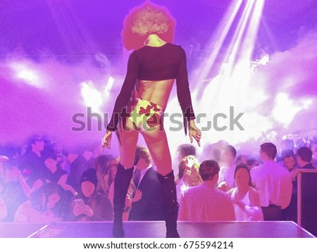 Woman dancing in night club party