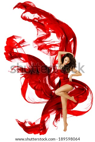 Woman dancing in red dress, fashion model dance whit waving fluttering fabric over white background - stock photo