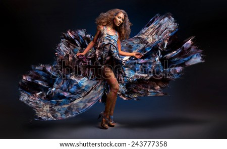 Woman dancing with flying dress - stock photo