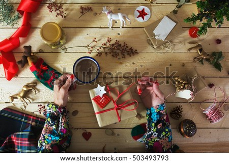 Do it yourself decoration sparkling do it yourself design ideas awesome woman decorating a christmas present with a branch of holly with do it yourself decoration solutioingenieria Image collections