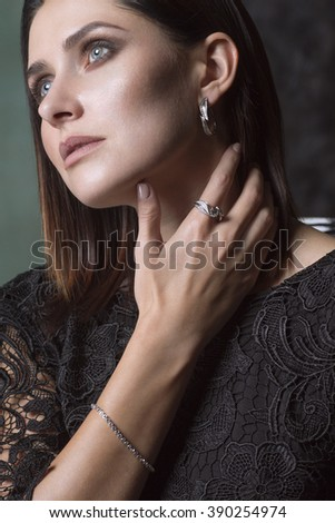 Woman Deep in Thought. Gold and Diamond Jewelry - stock photo