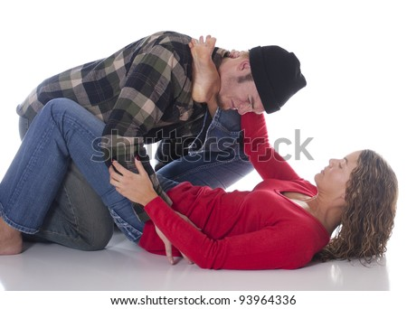 Woman defending herself against an attacker with a Jiu-Jitsu ankle choke - stock photo
