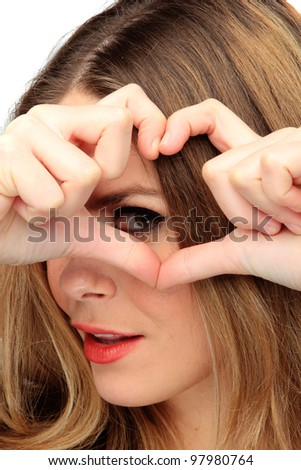 woman depicts the heart as hands