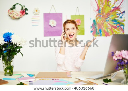 Woman designer happy receiving order from a client - stock photo