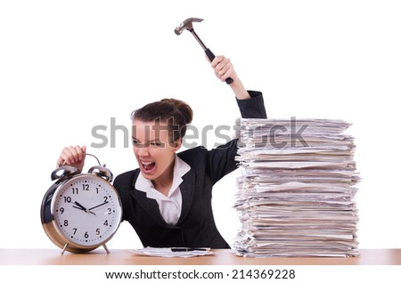 Woman desperate with time hitting clock with hammer - stock photo