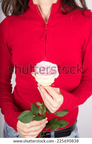 woman detail with a flower in her hands - stock photo