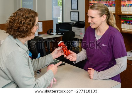 Woman discussing medication at vet office