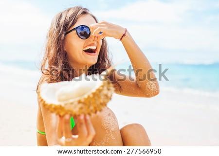 woman dislikes eating durian  - stock photo