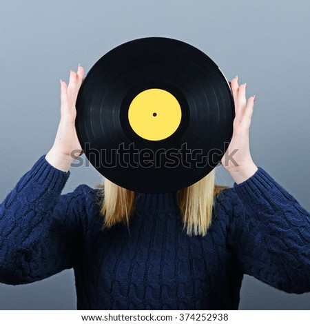 Woman dj portrait with vinyl record against gray background