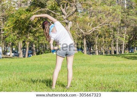 Woman do stretching exercise at sport arena